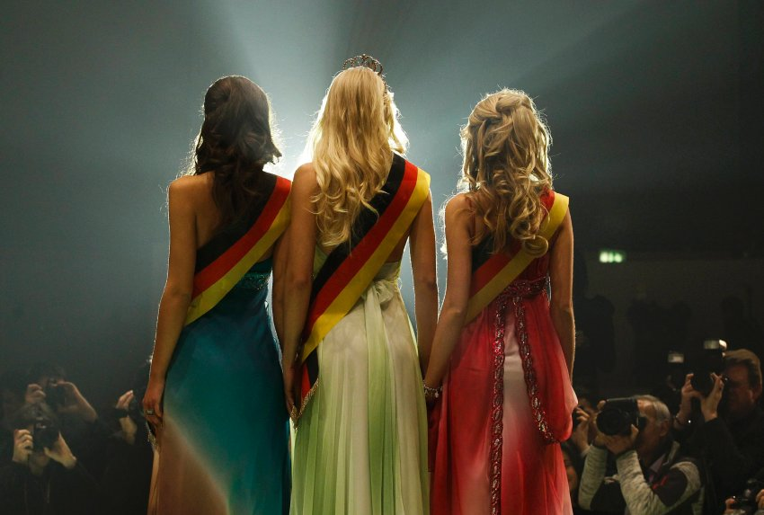 Miss Germany Kosch poses for photographers with second-placed Sachs and third-placed Striegel after the final of the beauty pageant in Rust